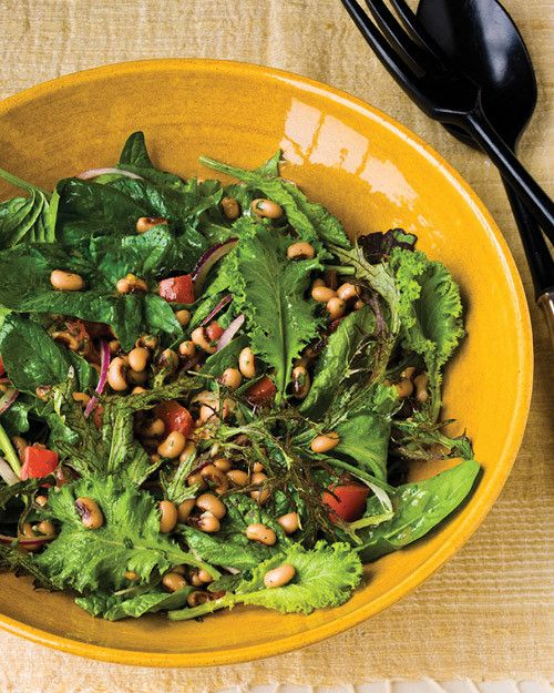 Canned black-eyed peas are tossed in a Dijon mustard vinaigrette with tomato, red onion, garlic, and cilantro, and served on a bed of fresh spinach and baby mustard greens. This easy black-eyed pea salad is best prepared a day ahead of time, so the beans can absorb the dressing.