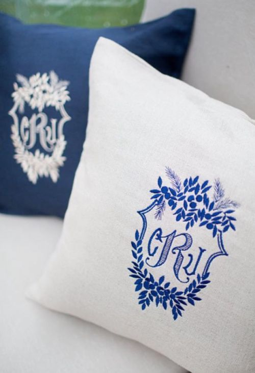 Wedding crest embroidered on pillows for reception.