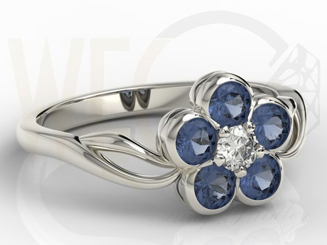 Pierścionek w formie kwiatu z białego złota z szafirami i diamentami /  Flower-shaped ring made from white gold with diamonds and sapphires / 2329 PLN #jewellery #jewelry #gold #ring #flower #diamonds #sapphires