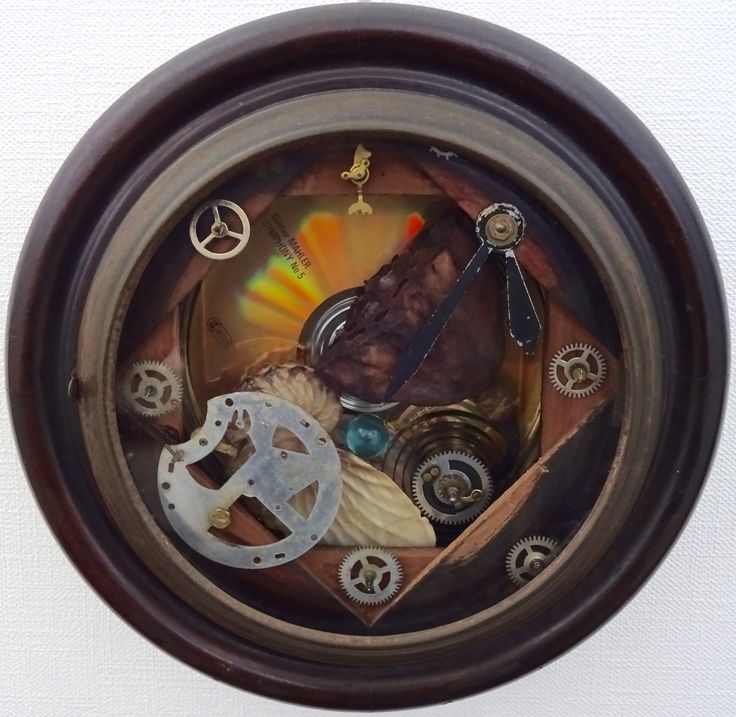 """<The Ark of Potalaka> 11/29/2015    by Masahide Kobayashi (小林正秀) 21(φ) × 7(D.) cm Mixed Media :  Outer Case, Inner Gear, Spiral Spring, Hour Hand and Minute Hand of Round Rosewood Wall Clock ; Body of CD Tin Can ;  Evaporated 24K Gold CD (G.Mahler's """"Symphony No.5"""") ;  Dried Lotus Flower Pod with Seeds ; Paper Nautilus (Winged Argonaut) Shell ; Giorgio Beverly Hills WINGS Eau de Toilette Mini Clear Glass Bottle ; White Lotus (Pundarika) Essential Oil"""