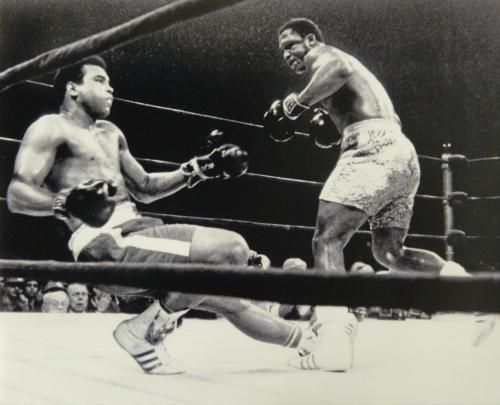 Joe Frazier knocks down Muhammad Ali