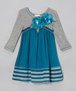 Dresses are a style staple for girls, and this fun-loving frock is a cut above the rest with its hue-on-hue color blocking and pretty flower accents. Stretchy material and a swinging silhouette ensure comfort for all-day play.