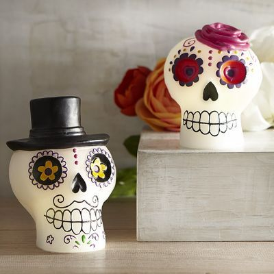 Made exclusively for Pier 1, our loving—and lovely—Day of the Dead couple are ready to light up your Halloween festivities. Each hand-painted, flameless LED has a timer so you can control when it starts and stops every day.