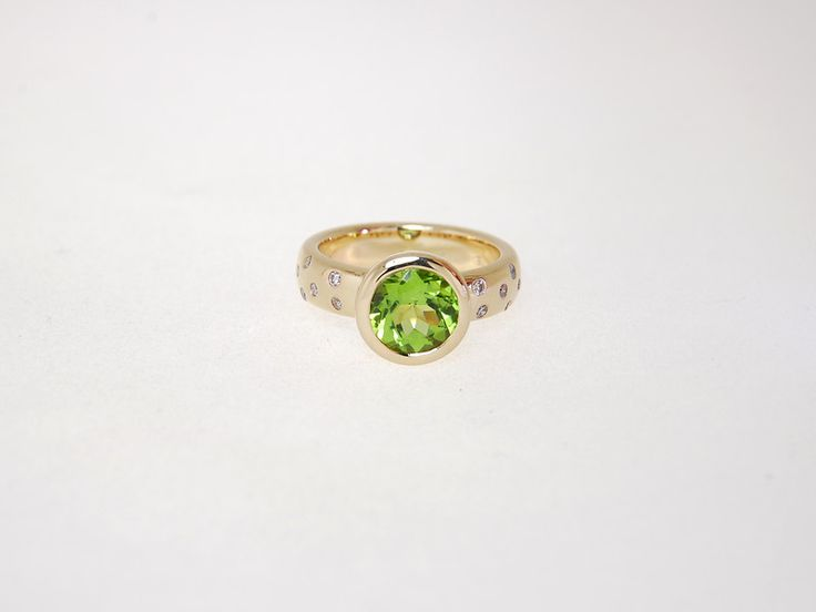 -CM485r- 9ct yellow gold ring with the prettiest peridot i've ever seen. The colour next to the yellow gold was just stunning. The little diamonds in the band just give it a bit of extra sparkle. This ring is sold. Let us create a special ring for you. Check out our website https://jewelbeetle.co.nz or our gallery on smugmug https://jewelbeetle.smugmug.com