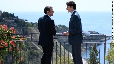 Canadian Prime Minister Justin Trudeau (R) and French President Emmanuel Macron talk as they attend the Summit of the Heads of State and of Government of the G7, the group of most industrialized economies, plus the European Union, on May 26, 2017 in Taormina, Sicily. The leaders of Britain, Canada, France, Germany, Japan, the US and Italy will be joined by representatives of the European Union and the International Monetary Fund (IMF) as well as teams from Ethiopia, Kenya, Niger, Nigeria and…
