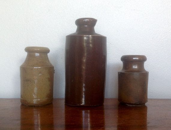 Three English Stoneware pots in contrasting sizes and colours, from the early part of the 20th century.  All three show signs of their great age with either small chips or discolouration...which adds to their charm. Please study pictures carefully to see their condition.  The first one is 3 tall by 1.5 across. The second is 4.5 tall by 2 across. The third is 2.5 tall by 1.4across.  Please note: We are happy to post our vintage items anywhere in the world. As they would be sent tracked and…