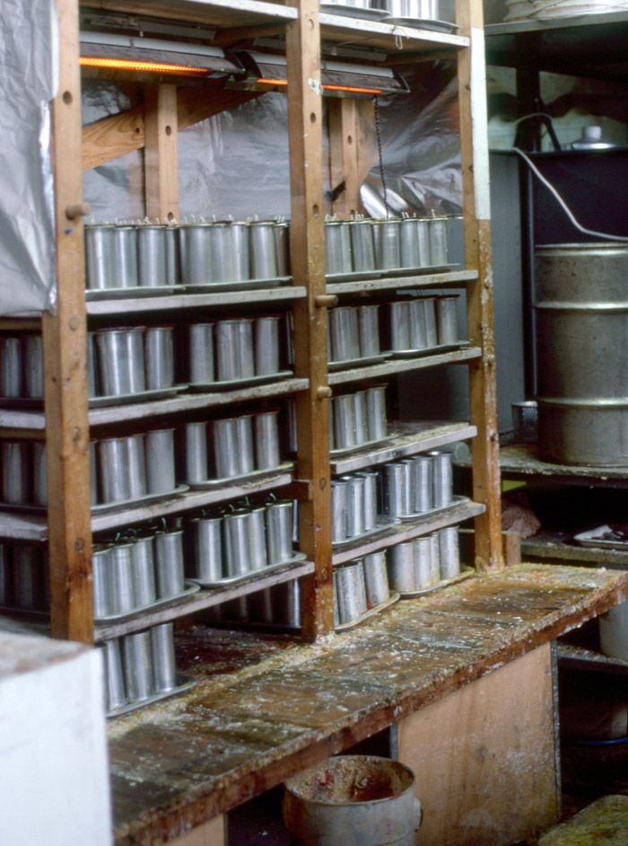 Our candle-making area - circa late 80's.  Trays and trays of our empty aluminium moulds, warming under heat lamps in readiness for the day's first candle batch.