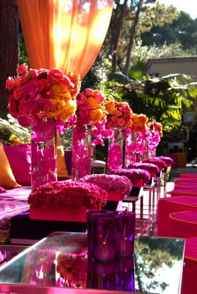 These orange and pink #roses #centerpieces are accented with fuchsia #orchids. Simply beautiful!