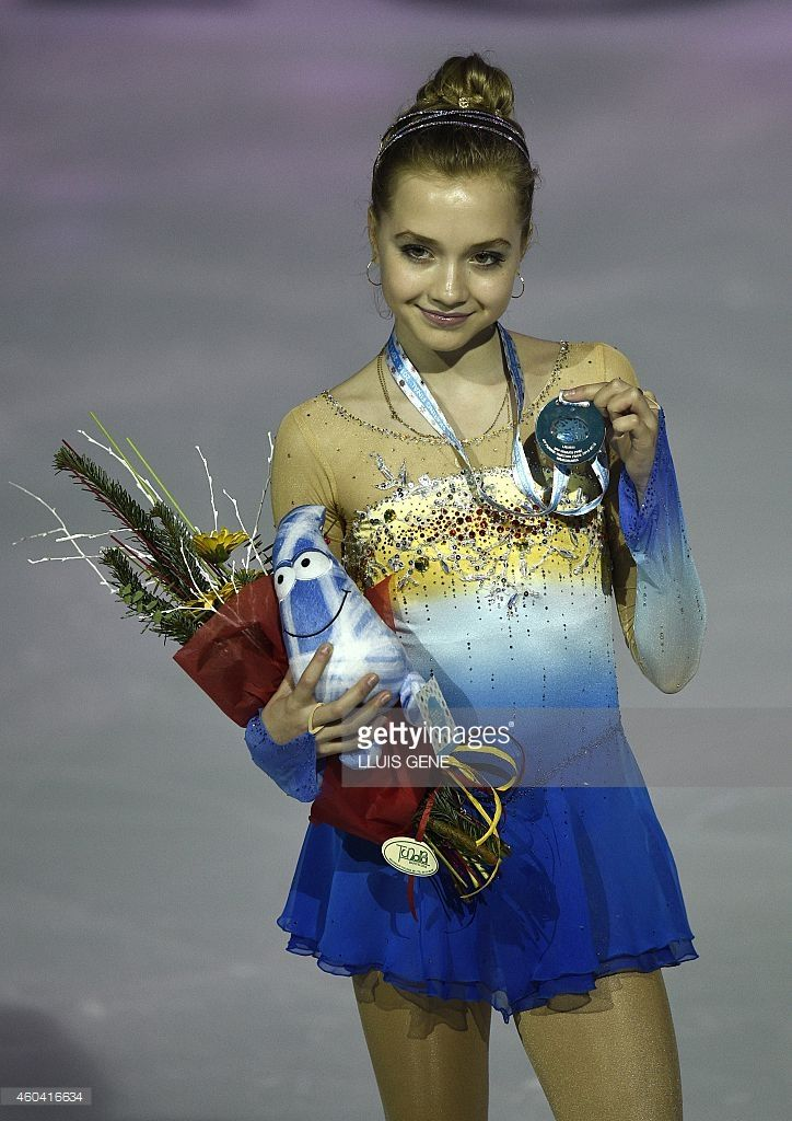 Second pleced Russian Elena Radionova poses on the podium during the awarding ceremony for the Ladies Free Skating at the ISU Grand Prix of figure skating Final 2014 in the Barcelona International Convention Centre, on December 13, 2014.