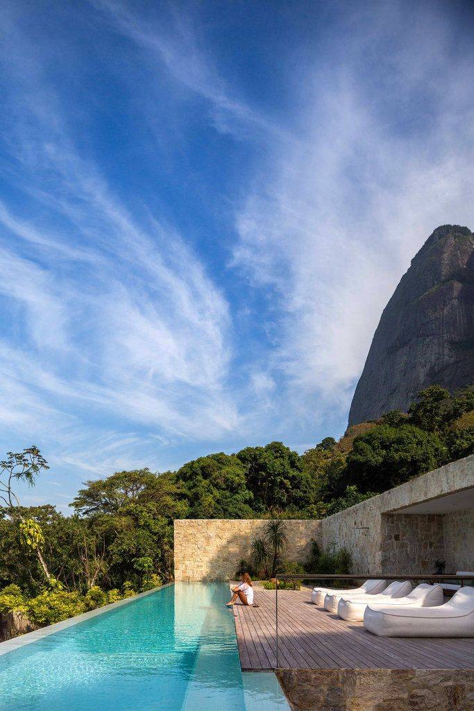Pedra da Gávea, the 2,769-foot granite dome that is a popular spot for paragliding, is the backdrop for Alex Lerner's house in Rio de Janeiro. Mr. Lerner, the host of a Brazilian television show, built the home to evoke the feeling he has when he vacations on St. Barts.