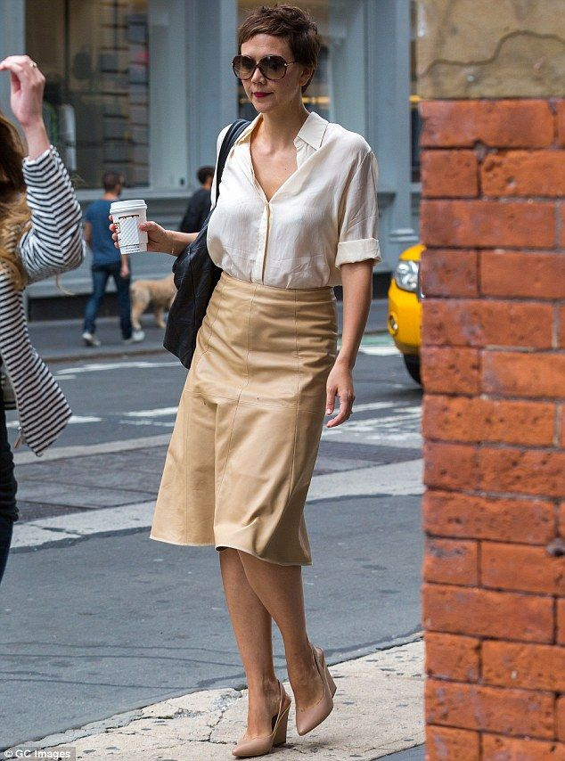 Stylish in the city: Maggie Gyllenhaal looked chic in a loose cream blouse and tan leather-like skirt as she ran errands in SoHo http://dailym.ai/1ldRhTn