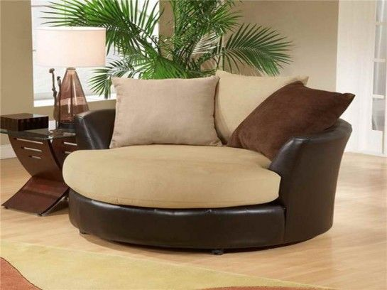Cuddler swivel sofa chair cuddle chair the ultimate for Snuggle sofa