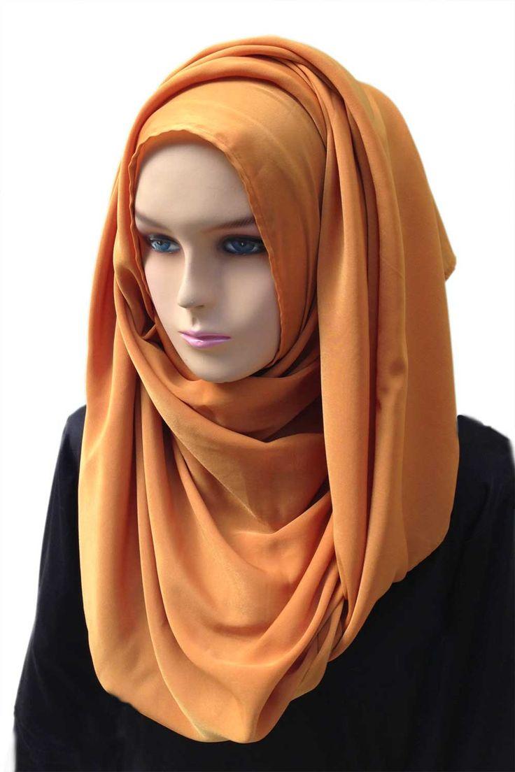 "Cadmium Scarf Hijab description:  Color: Bronze to Orange Length: 78"" or 200cm Width: 29"" or 75cm   http://hijabila.com/product/plain-orange-hijab/"