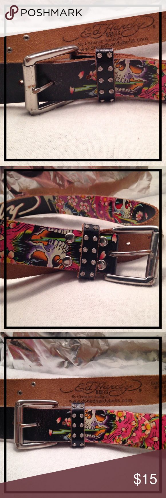 GENUINE LEATHER ED HARDY BELT | CHRISTIAN AUDIGIER ☠🌹 ED HARDY GENUINE LEATHER BELT 🌹☠  By Christian Audigier.  🌹🌵 Love-Worn 🌵🌹 🌹Size: S (Strap measures: 48inches, Buckle measures: 2 inches, 50in. Total) 🌹Color: Black w/ skulls & flowers 🌹Circa: 2008-2012   In good condition. Has white crazing spidering on black parts of belt in places, but it actually blends. No rips, tears, or scratches present. The belt has been in the Arizona environment its whole life & shows the signs of low…
