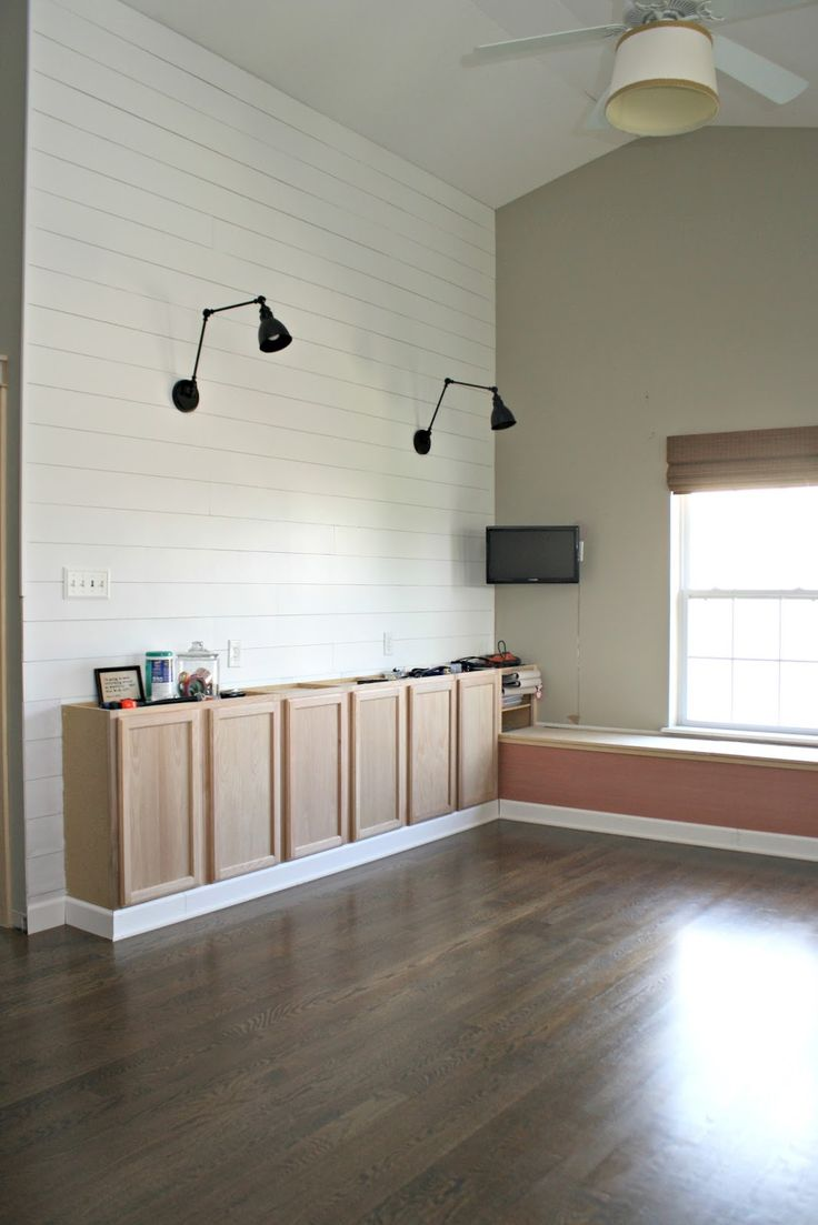 Wall sconces and built in storage in the craft room!