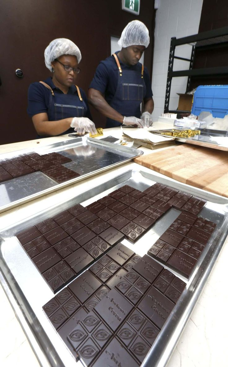 WAYNE GLOWACKI / WINNIPEG FREE PRESS</p><p>Aschenti Cocoa owners Christelle (left) and Christian Mekoh hand-wrap chocolate bars (above) and show ingredients (top) in their new shop.</p></p>