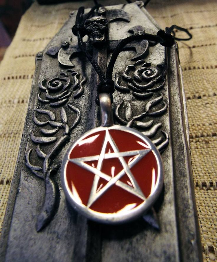 Handmade pentagram pendant made from Fine Pewter with red enamel detail.