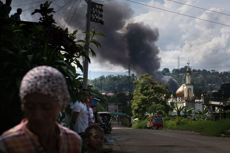 """RAMADAN - """"MONTH great achievement""""  Smoke rises from the place of fighting in the city of Marawi, in the southern Philippines,  May 30. Philippine army is fighting with the Islamic terrorist"""