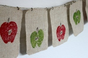 Fall banner, with apples cut in half, burlap and paint.