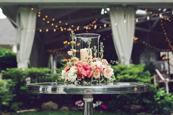 candle and floral centerpiece on bar table