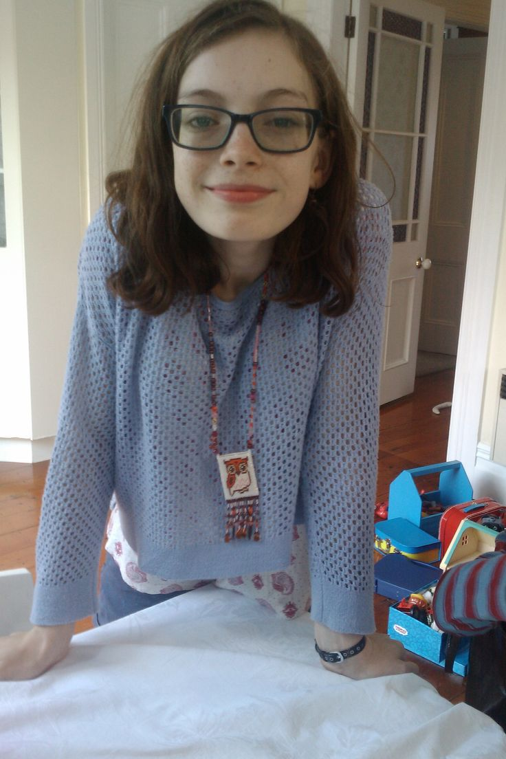 Grandie Eloise wearing the owl amulet bag necklace I designed and made for her 12th birthday.  On the other side of the bag is a large E.