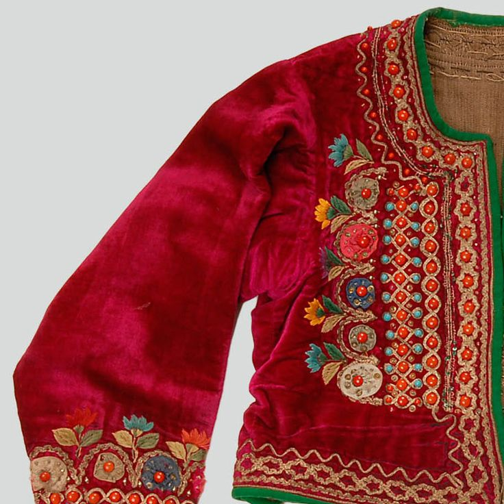 Woman's velvet katana jacket. Decorated with haberdashery trimmings, buttons, sequins, beads, embroidery. Trimmed with green wool. Fastened with hooks and eyes. Machine and hand-sewn.    Western Krakowiak Folk, Zielonki, P. Kraków, early 20th c.