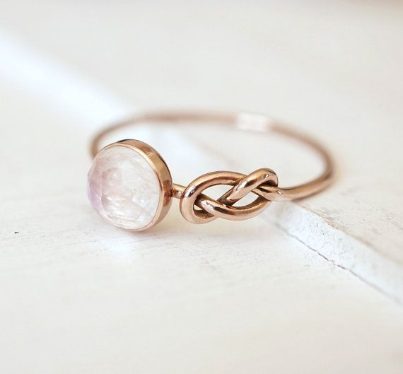 Moonstone Ring, Infinity Knot Ring, Engagement Ring, Blue Moonstone Jewelry, Gift for her, Promise Ring, Push Present, Anniversary Gift  Our gorgeous Rainbow Moonstone nestled perfectly beside an infinity knot. This ring made from 100% recycled 14k gold lets her heart beat faster! Ideal gift as push present, promise ring, non-traditional engagement ring or birthday gift.  I can make this ring in 14k Rose Gold, 14k White Gold or 14k Yellow Gold. - 6mm rose cut Rainbow Moonstone nestled…
