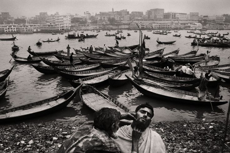 "Open salon at the riverbank, Buriganga, 2005. From the series ""Belonging"" © Munem Wasif"