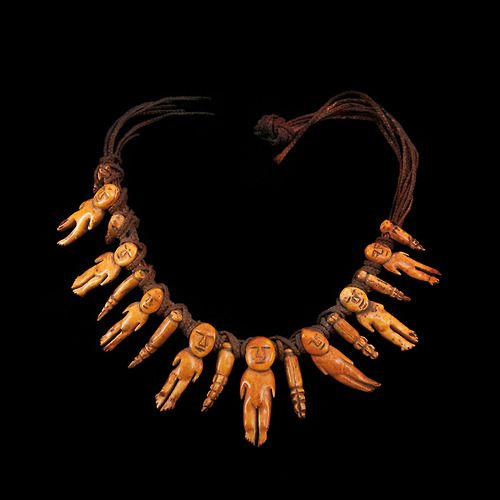 ancientart:        Tongan necklace, the figurative composition of this adornment is extremely rare, it carries eight figures and nine other pendants, all pierced for suspension and bound by sennit cord.