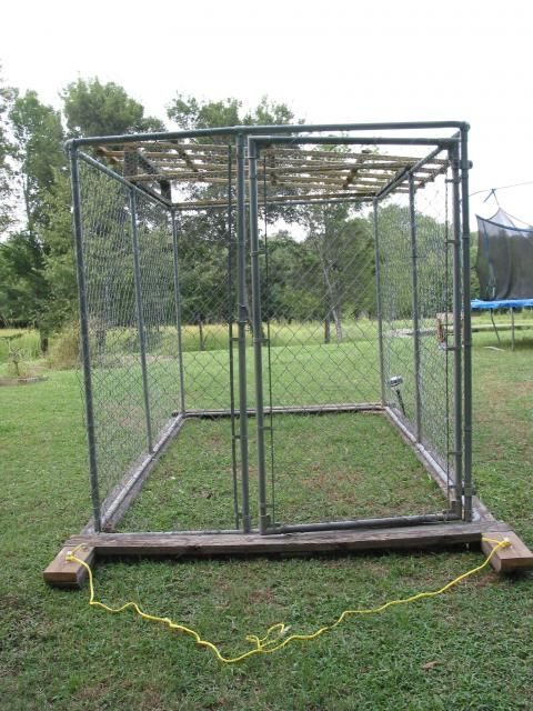 boards underneath allow dog pen chicken coop to be moved