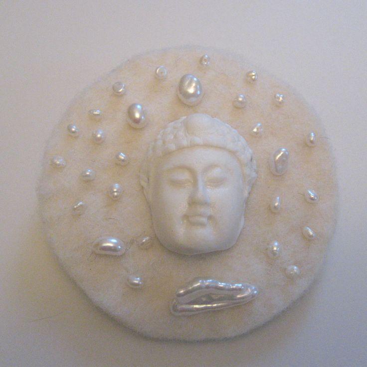 Buddha in snow Design Marja Arola