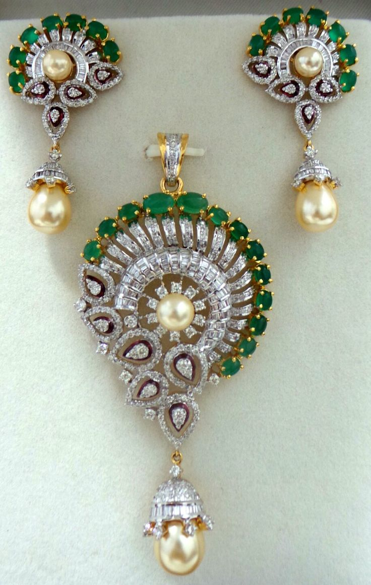 Beautiful Pendant Set Studded With Round, Tapers & Pear Shaped Diamonds With Emeralds & Pearls