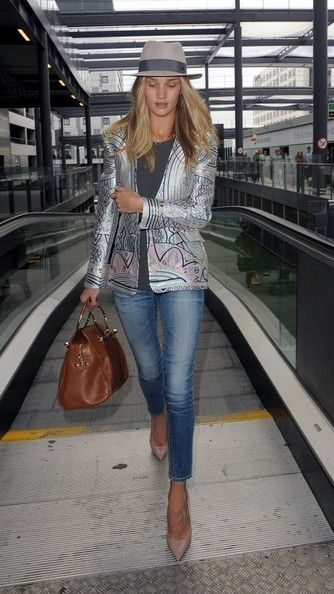 Rosie Huntington-Whiteley arrives at Gatwick Airport to board a flight to Cannes, France.