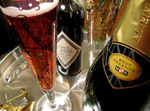 I love kier Royals I add pomegranate seeds and serve--Champagne and Creme de Casis.  The best place to find Creme de Casis is at Vendome