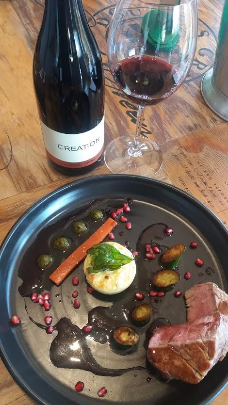 Beef Fillet with courgettes, Parmesan souffle, tomato jelly and pesto - paired with Creation Wines Syrah Grenache.