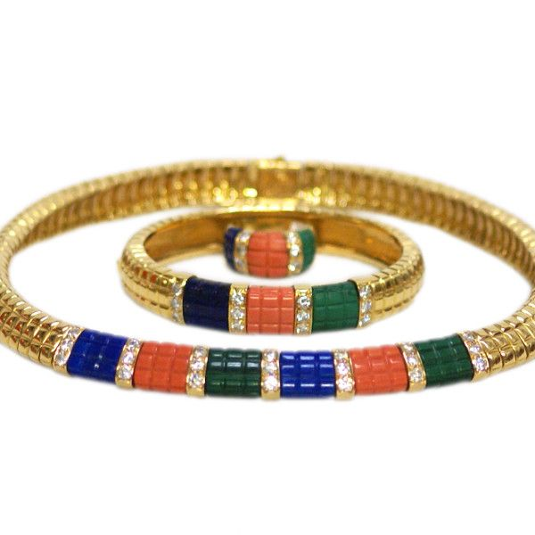 A sophisticated set comprised of necklace, bracelet and ring; of geometrical design, presenting alternated lapis, coral and malachite rectangular elements, highlighted and divided my diamond pavè sections. Signed Van Cleef & Arpels, circa 1985.