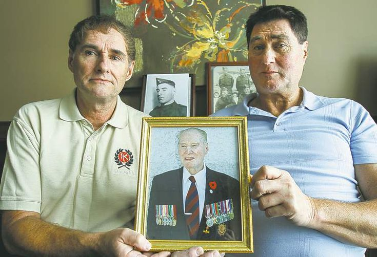 So dedicated, he enlisted twice. First in the Battle of Hong Kong 1941 - Dennis Bell (left) and brother, Bill, hold a photo of their father, Lance Cpl. William Bell of the Winnipeg Grenadiers, who died Tuesday on his 96th birthday (2013). He was a Hong Kong veteran.