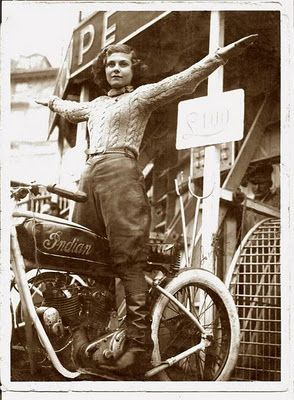 Vintage photo of female Wall of Death rider on Indian motorcycle. Circa 1940's.