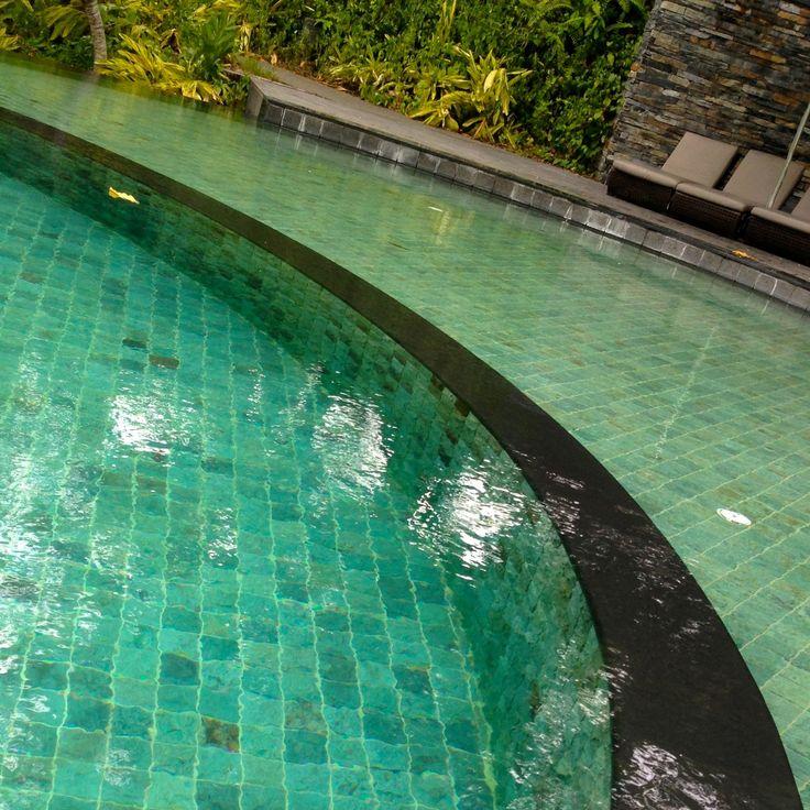Sukabumi stone creates beautiful aqua marine tone in deeper water.  Much greener in shallow water.