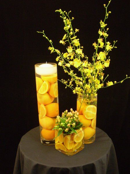 I really like the citrus idea... I'd do it with limes and I could maybe incorparate some pink flowers through there
