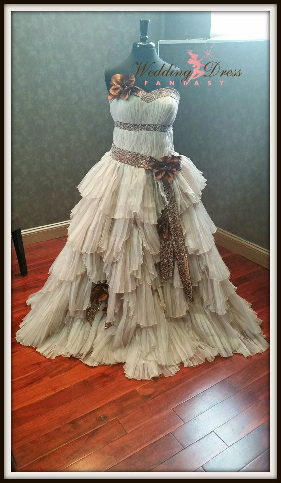 Steampunk Wedding Dress from WeddingDressFantasy.  The base layer is made with high end Champagne Bridal Satin. The overlay is made with a