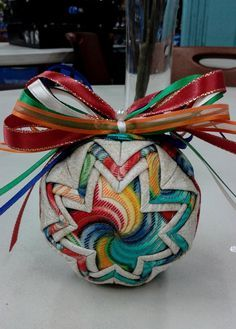 Folded fabric Christmas Ornament - Multi Color swirl Coordinating ribbon sets it off and makes it unique. Back is the same pattern/look as
