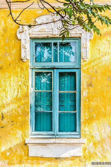 Shutters painted to match the exterior window frames. Porto Alegre, Rio Grande do Sul, Brazil