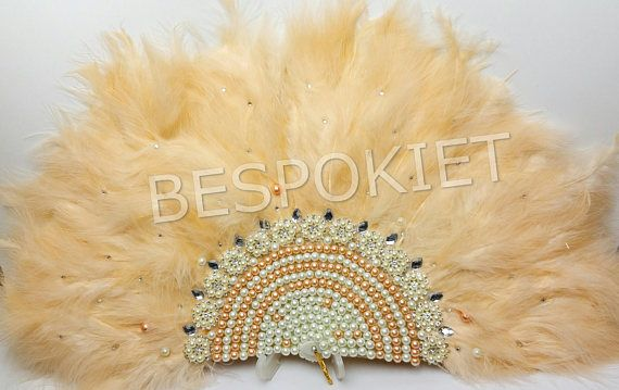 Choice explanation  - no brooch front&back ; The back will have feathers all around  - brooched front&back ; The back will have feathers all around   Custom made non-foldable Feather Hand fan Nigerian engagement hand fan finished off with beads and diamante brooch  Check out more of our