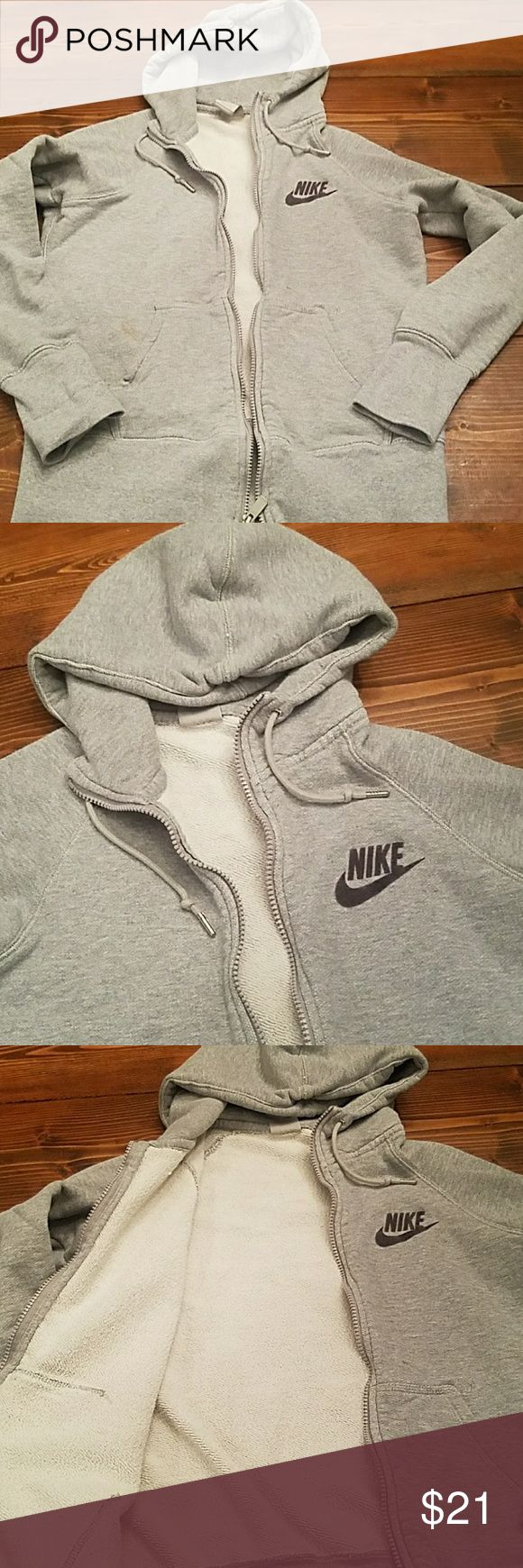 Women's Nike Jacket Fits Like A Medium Grey Nike Zip up hoodie jacket. Super warm! this has a light stain near left pocket and on lower left sleeve (see pics). This is a large, but it fits like a medium IMO. Nike Jackets & Coats