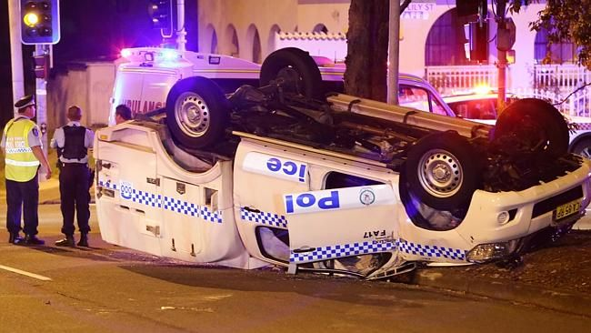 A police vehicle crashed and rolled on Prairie Vale Rd at Prairiewood. Picture: Bill Hear