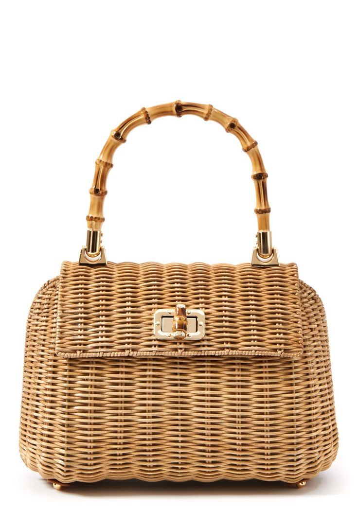 """Picnic Satchel in Natural by J.McLaughlin. Picnicking, one of our favorite weekend activities inspired our structured wicker bag. A bamboo handle adds an organic element while gold tone trim elevates the overall look. •Turnlock closure •Lined •Interior pouch pocket •Protective metal feet • 7.5""""H x 12""""W x 5.5"""" D, 5"""" handle drop"""