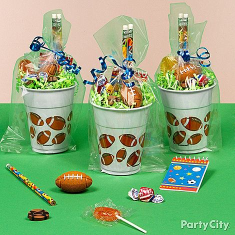 football birthday party favor bags | send the party players home with victory favors in football favor cups ...