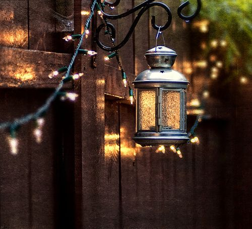 ~Lovely white lights across a privacy fence and lantern bracket.