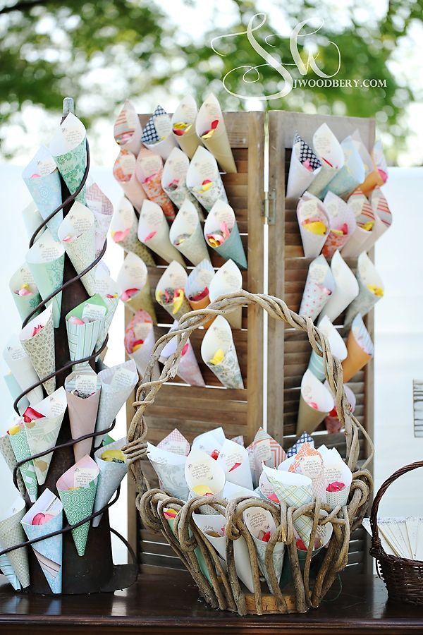 Upon arrival to the ceremony guests picked up cones created from craft paper which were filled with rose petals to be tossed as the couple exited the aisle | by Dorothy McDaniel's Flower Market